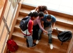 Four students in stairwell.jpg
