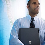Image of a businessman in front of map