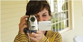 A woman with a camcorder