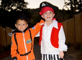 Two boys in costume at dusk