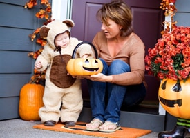 Child trick-or-treating in bear suit