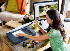 Picture of woman scanning photos with the HP Scanjet G3110 photo scanner