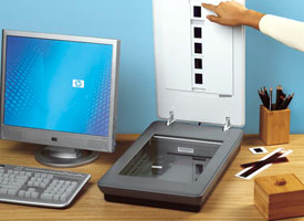 Picture of person scanning negatives with the HP Scanjet G4010 Photo Scanner