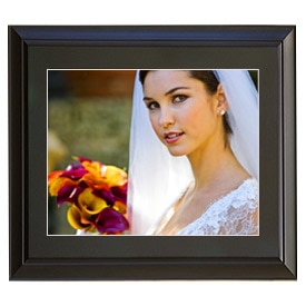 "An 8"" x 10"" wedding photo displayed in a black frame"