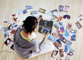 Woman on floor with photos