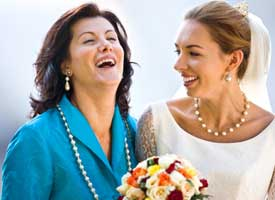 Bride and mother laughing.