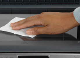 hand wiping off scanner glass