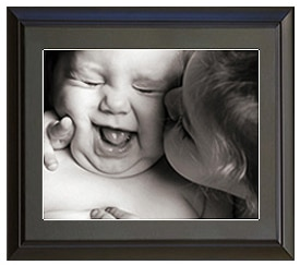 Black and white photo of a baby in a frame
