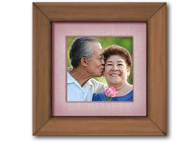 Husband and wife in a frame with a pink border