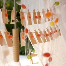 baby shower wish cards hanging from string