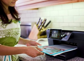 Woman printing in kitchen.