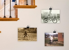Picture of photos hung from binder clips