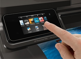 Hand using PS 7510 touchscreen to access print apps