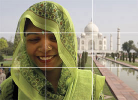 Smiling woman with Taj Mahal in background