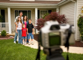 Picture of family being photographed with camera on tripod