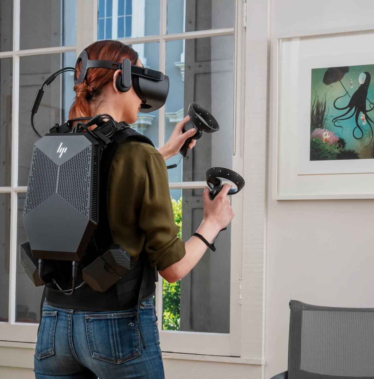 person wearing vr backpack, headset and hand controls