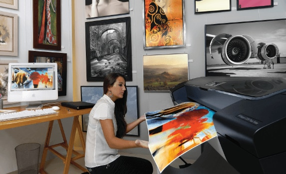 Woman printing an illustration with the HP Designjet Z3200 printer