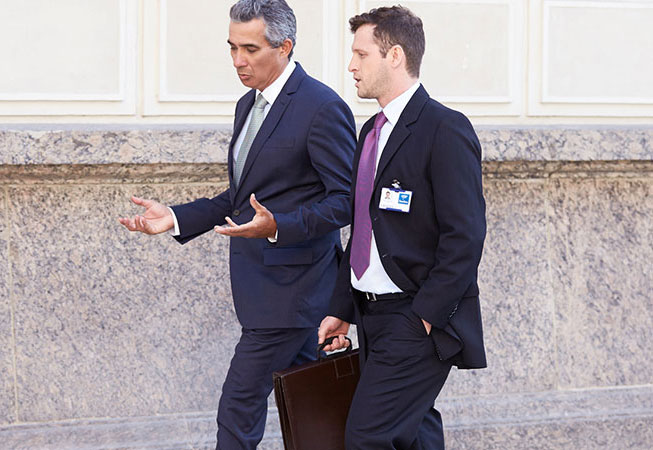 business partners talking while walking