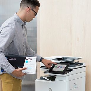 A woman taking out the printed images from an HP printer