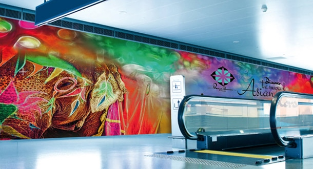 Colorful banner next to airport conveyor walkway