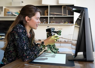 Image of a woman working on an HP Sprout