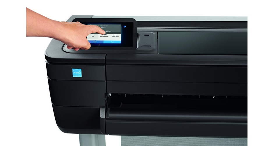 Close-up view of the HP DesignJet T730 Printer with technician pressing the touchscreen display