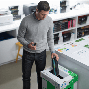 A man put an empty cartridge to an HP Recycle box