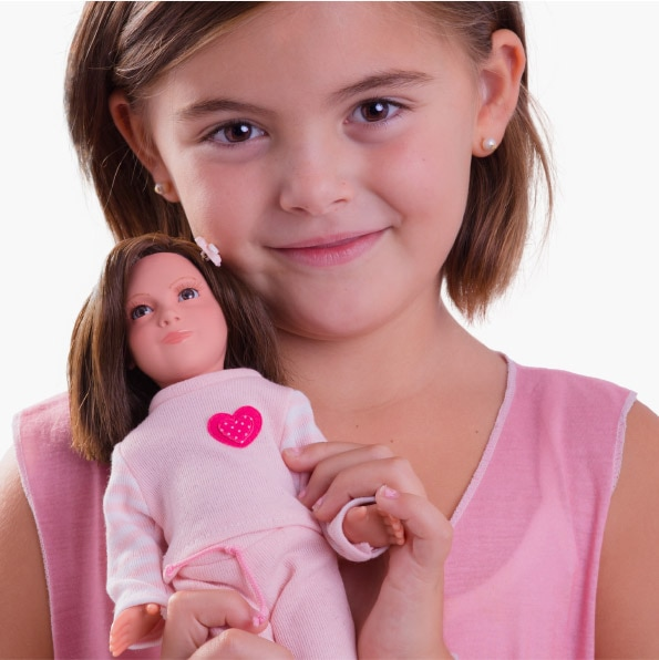 Little girl holding a 3D printed doll