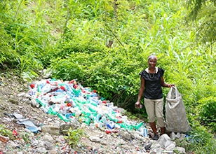Image of Rosetta in Haiti posing next to plastic bottles
