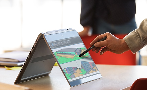 Convertibles for business - A hand holding a stylus and drawing on the screen of one of our HP ZBook business convertibles