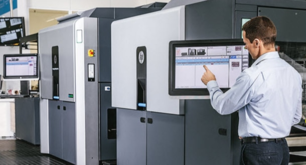 Man looking at monitor on HP Indigo press