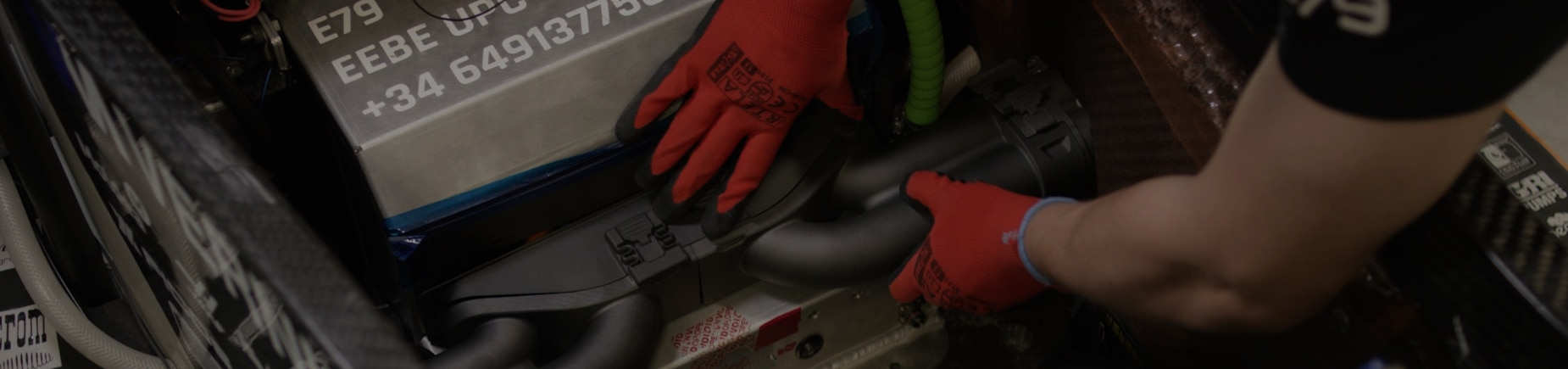 Close-up of hands working on engine