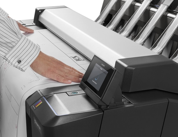 Technician printing from an HP DesignJet printer