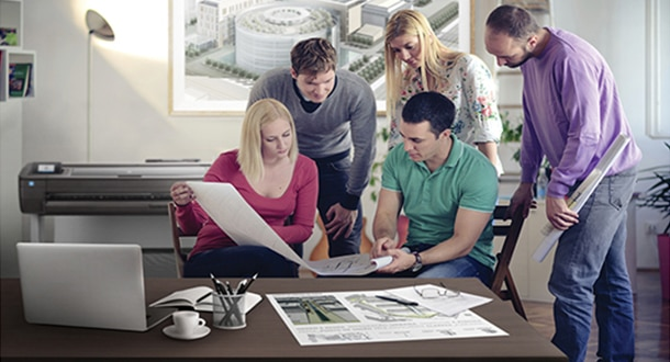 Group of people reviewing blueprints