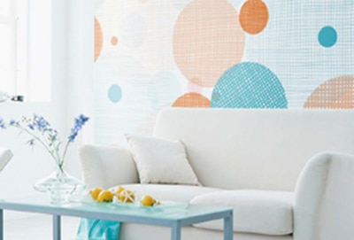 White couch and chair with vibrant wallcovering