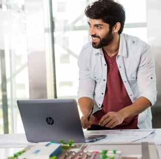 Young man with an HP laptop