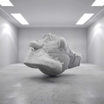art, tennis shoes sticking to a basketball in a room