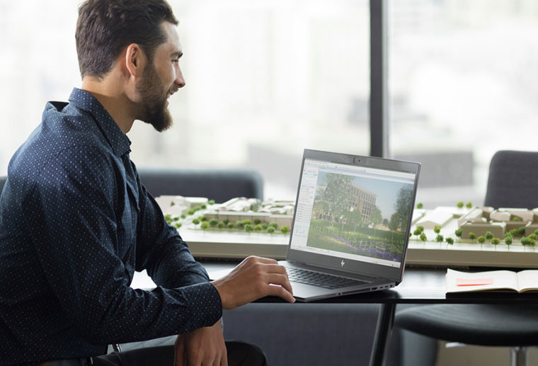 Architect reviewing plans on the Zbook studio laptop