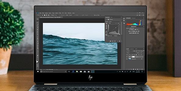 HP spectre 3D photo editing example of ocean photos on open screen