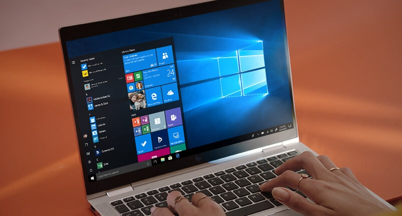 Elitebook open facing right with hands typing on screen