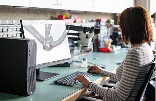 Product designer working with HP Z2 Small Form Factor in office environment.