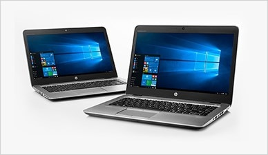 Two stylish HP notebooks sitting side by side