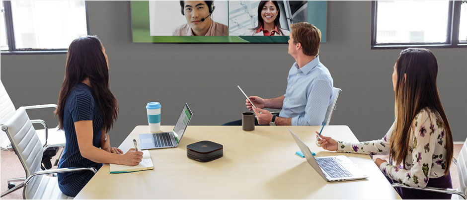 HP Slice for Meeting Rooms shown in a conference room setting with a large format display mounted on the wall