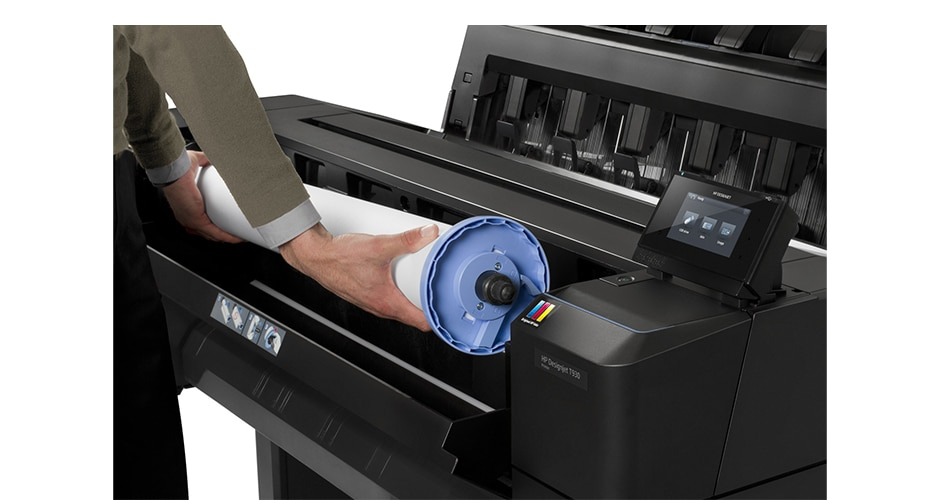 Technician changing paper into an HP DesignJet T930 Printer