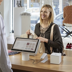 woman shopping in the clothing store with hp pc system offering retail solution