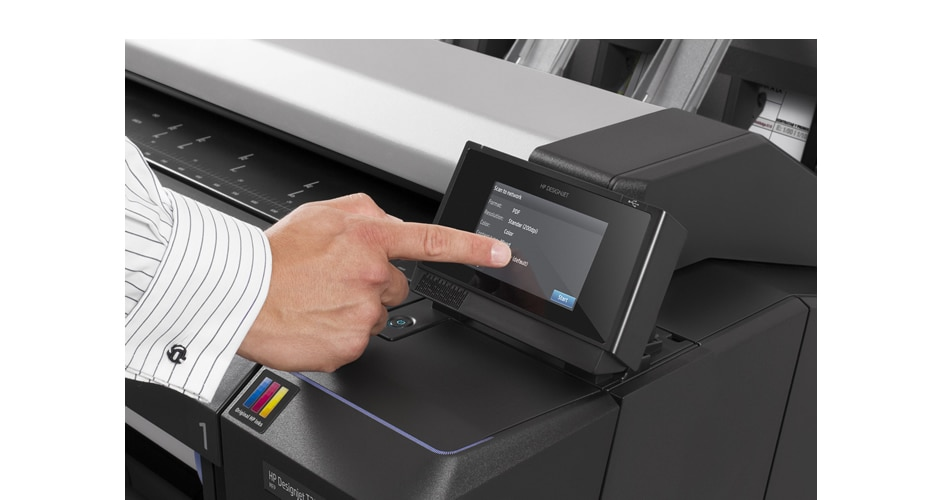 Close-up view of the HP DesignJet T2530 Printer with technician pressing the touchscreen display