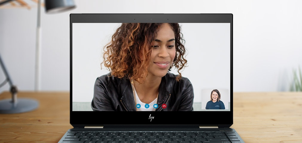 HP spectre open laptop screen showing video chat on screen