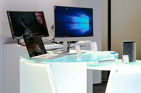 Image of HP laptop, all in one and workstation tower in display