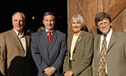 Former HP CEO John Young, Mark Hurd, Susan Packard Orr and James Hewlett paused their conversation for a photograph in front of the landmark garage.