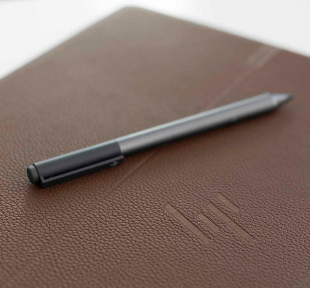 Spectre tilt digital pen sitting on the leather back side of the Spectre folio